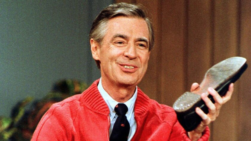 FILE - This June 28, 1989, file photo, shows Fred Rogers as he rehearses the opening of his PBS show