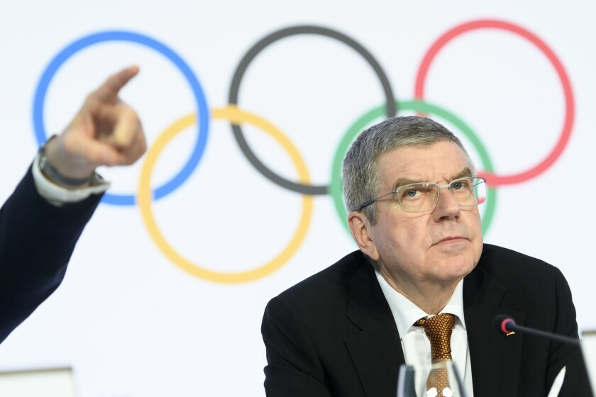 International Olympic Committee (IOC) president Thomas Bach attends a press conference after the executive board meeting of the IOC at the Olympic House, in Lausanne, Switzerland, Thursday, Jan. 9, 2020. (Laurent Gillieron/Keystone via AP)