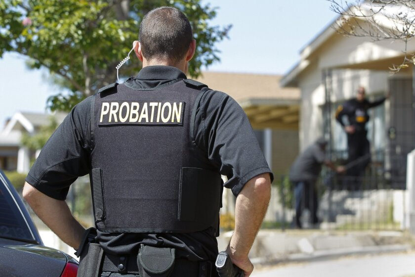 County probation officers conduct compliance checks on offenders under supervision in City Heights.