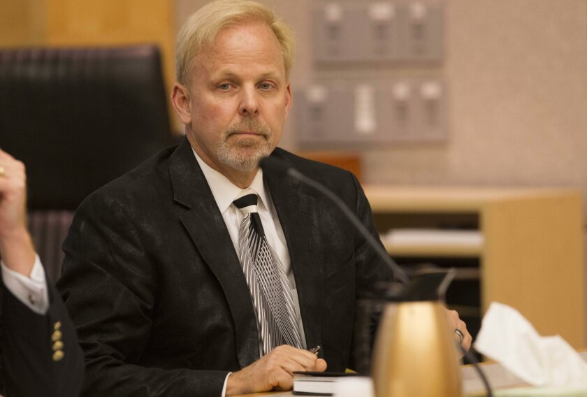 """Robert O. Young, the author of the popular """"pH Miracle"""" book series, was convicted last month on two counts of practicing medicine without a license, and acquitted of a third such charge. The jury deadlocked on six other counts, including theft by fraud. On Monday, a prosecutor said Young — seen here in a January photo during his trial — will be retried on those six charges."""