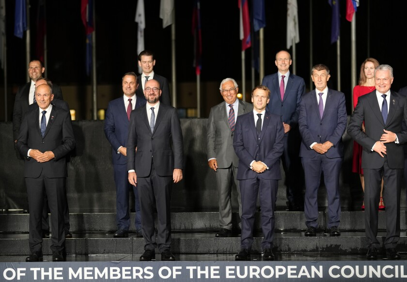 Front row left, to right, Slovenia's Prime Minister Janez Jansa, European Council President Charles Michel, French President Emmanuel Macron and Lithuania's President Gitanas Nauseda pose with other EU leaders during a group photo at an EU summit, at the Brdo Castle in Kranj, Slovenia, Tuesday, Oct. 5, 2021. EU leaders are meeting Tuesday evening to discuss increasingly tense relations with China and the security implications of the chaotic U.S.-led exit from Afghanistan, before taking part in a summit with Balkans leaders on Wednesday. (AP Photo/Darko Bandic)