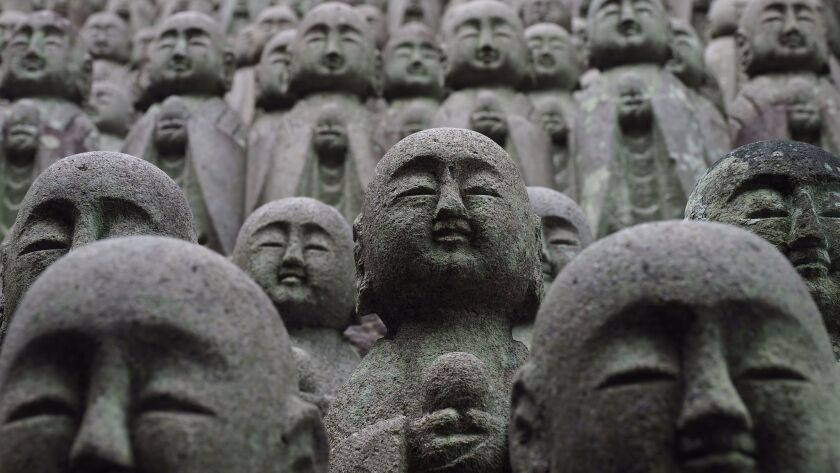 The Hase-dera temple in Kamakura is lined with statues of the deity Jizo, protector of those who need extra care.