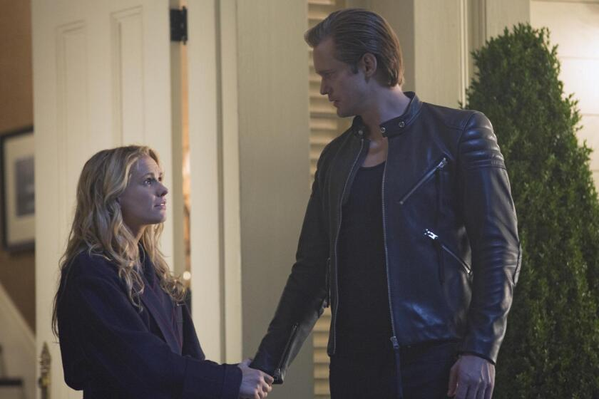 """Sookie Stackhouse (Anna Paquin) learns from vampire Eric Northman (Alexander Skarsgard) that there's an antidote for hepatitis V on """"True Blood."""""""