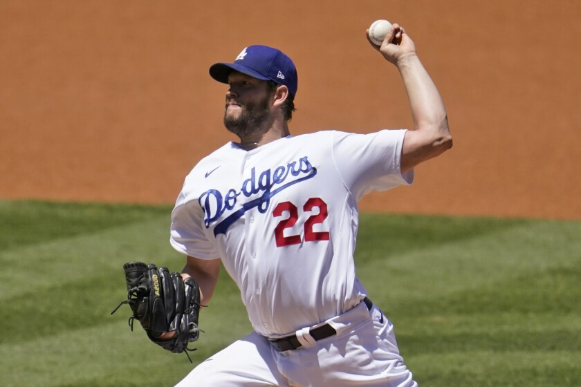 Dodgers pitcher Clayton Kershaw throws to the Cincinnati Reds.