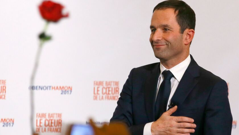 Benoit Hamon greets supporters after winning the Socialist Party presidential nomination in Paris on Sunday.