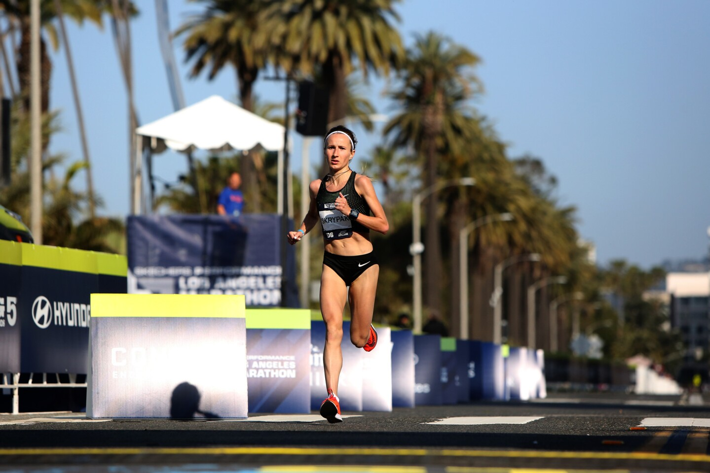 Runner Olha Skrypak finishes in fourth place for female runners during the Los Angeles Marathon on March 24.