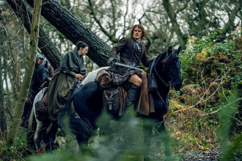 "Caitriona Balfe as Claire Randall Fraser and Sam Heughan as Jamie Fraser in ""Outlander."""