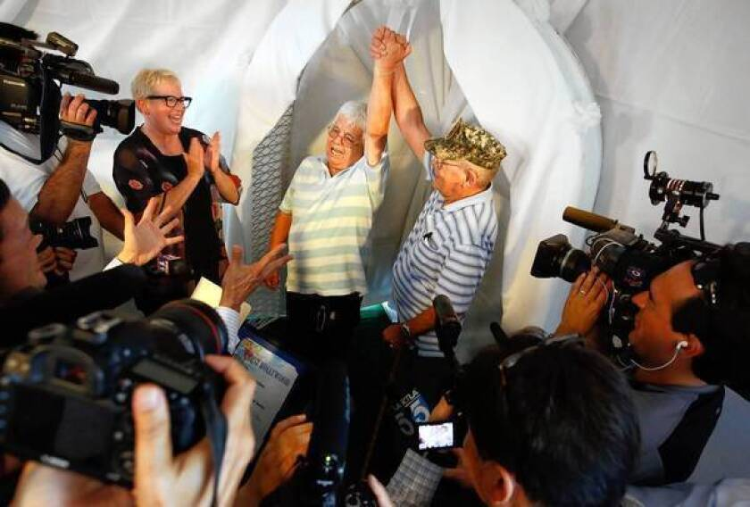 The wedding ceremony for Paul Mejia, 78, left, and David Barney, 70, was one of many held for same-sex couples outside the West Hollywood City Council chambers on Monday.