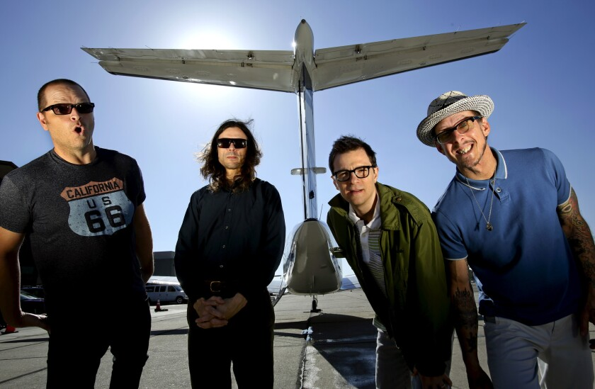 Patrick Wilson, left, Brian Bell, Rivers Cuomo and Scott Shriner of Weezer on the tarmac at Hawthorne Airport last year.