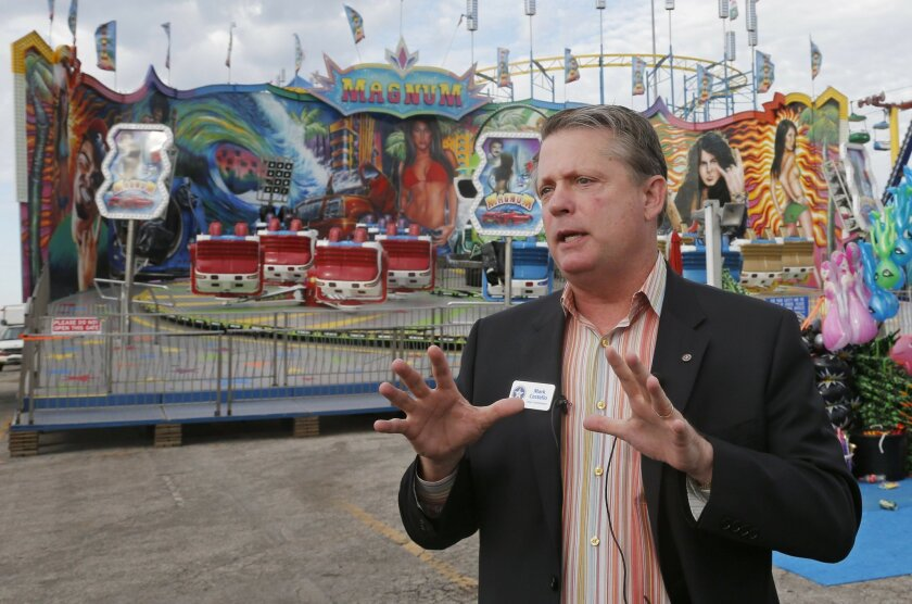 FILE - In this Wednesday, Sept. 10, 2014, file photo, Oklahoma Labor Commissioner Mark Costello speaks during a news conference at the state fairgrounds in Oklahoma City. Authorities say Costello has died after a stabbing at an Oklahoma City restaurant on Sunday, Aug. 23, 2015. (AP Photo/Sue Ogrocki, File)