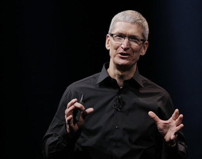 "In this Wednesday, Sept. 12, 2012 photo, Apple CEO Tim Cook speaks during an introduction of the new iPhone 5 in San Francisco. Cook says the company is ""extremely sorry"" for the frustration that its maps application has caused and it's doing everything it can to make it better. Cook said in a lett"