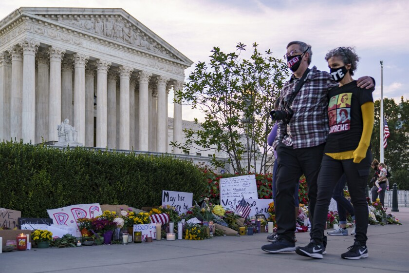 People gather outside the Supreme Court to mourn Justice Ruth Bader Ginsburg on the morning after her death.