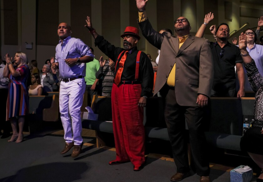 Members of the Calvario City Church in Orlando, Fla., worship during an October service.