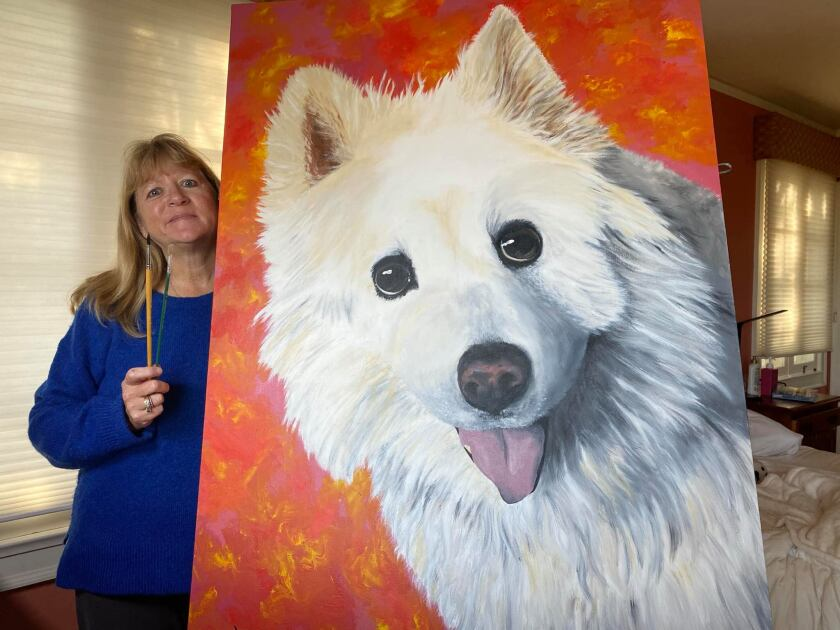Rebecca Reeb, an artist based in Point Loma, shows one of her pet portraits.