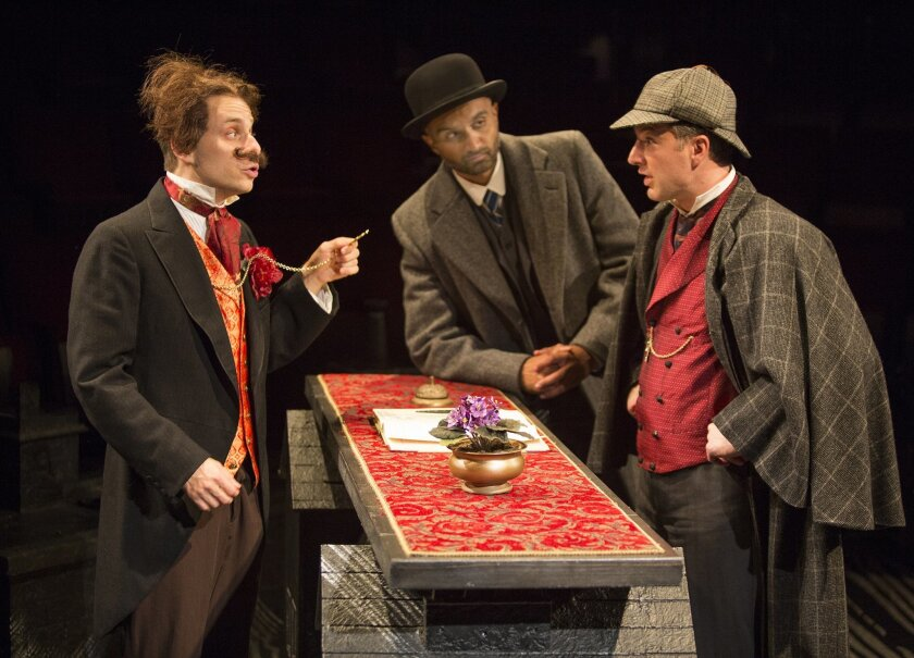 Blake Segal as Castilian Desk Clerk, Usman Ally as Doctor Watson, and Euan Morton as Sherlock Holmes in Ken Ludwig's 'Baskerville: A Sherlock Holmes Mystery,' directed by Josh Rhodes at The Old Globe Theatre.