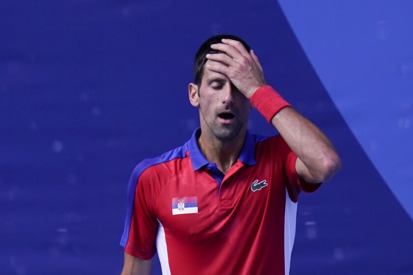Novak Djokovic, of Serbia, reacts during the bronze medal match of the tennis competition against Pablo Carreno Busta, of Spain, at the 2020 Summer Olympics, Saturday, July 31, 2021, in Tokyo, Japan. (AP Photo/Seth Wenig)