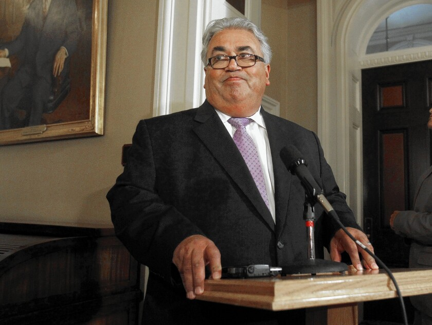 State Sen. Ronald Calderon, shown at a news conference at the Capitol in June 2013, is accused of fraud, money laundering and taking nearly $100,000 in bribes.