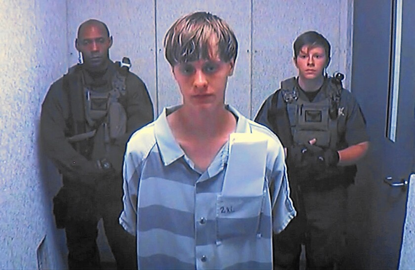 Dylann Roof appears before a judge via video last June. Roof is charged with killing nine people at a historic black church in Charleston, S.C.