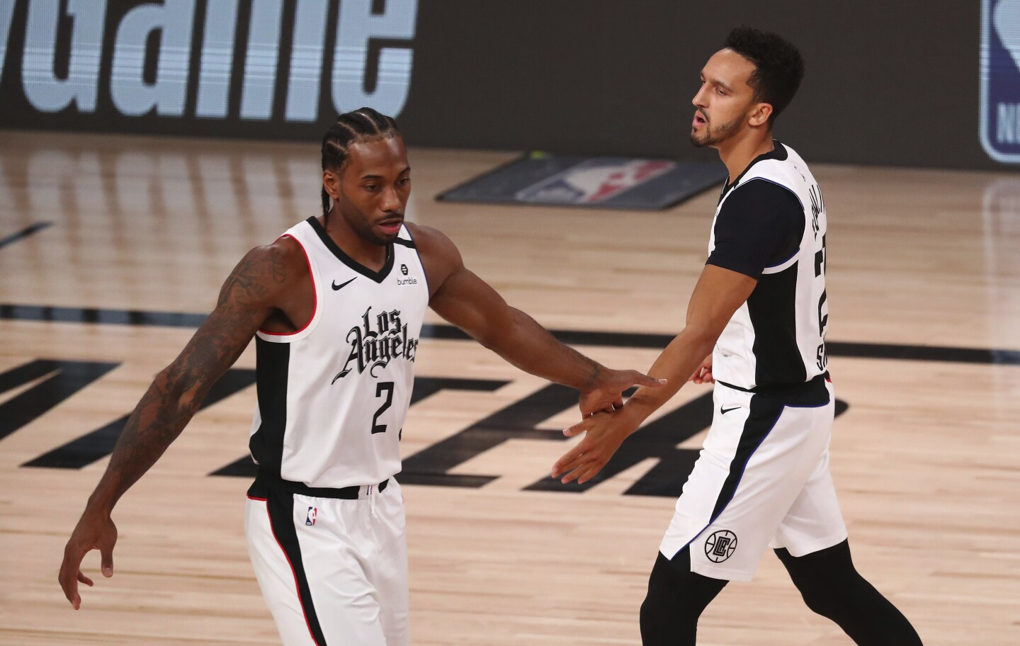 Clippers guard Landry Shamet reacts with forward Kawhi Leonard after a foul.