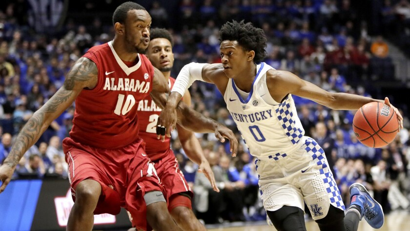 Kentucky guard De'Aaron Fox drives down the lane against Alabama forward Jimmie Taylor during the first half Saturday.