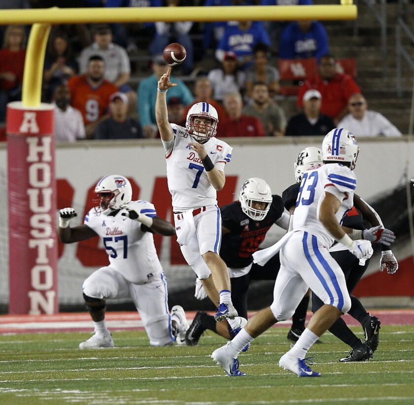 SMU's Shane Buechele (7) throws a pass across the middle to Kylen Granson (83) during the first half against Houston on Thursday in Houston.