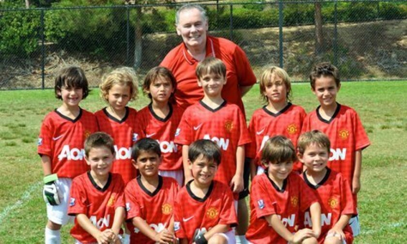 Coach Denis Sweeney with Manchester U7 boys (back row left to right): Carter Feinman, Eddie Douek, Nicholas Becerra, Spencer Reckles, Hans Zwerenz and Andrew Abeles. Front Row from left to right: Brayden Aires, Noah Benhaim, Diego Orosco, Tyler Kersey and Britain Kowalchek.