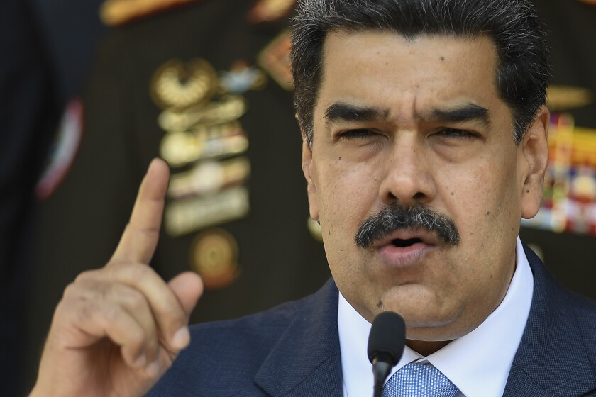 Venezuelan President Nicolas Maduro holds a news conference at Miraflores presidential palace in Caracas.