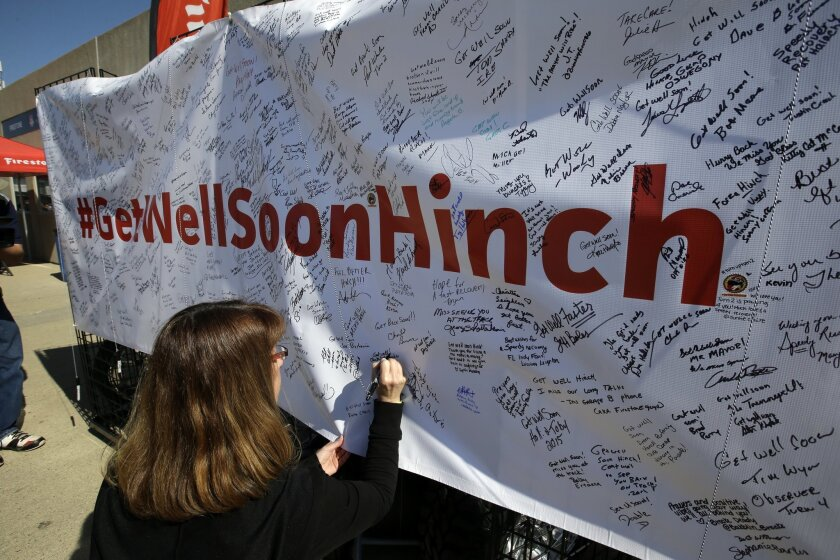 "Deb Sparks signs a ""Get Well Soon Hinch"" banner in the garage area before the practice session for the Indianapolis 500 auto race at Indianapolis Motor Speedway in Indianapolis, Friday, May 22, 2015. James Hinchcliffe, of Canada, was injured in a crash on Monday and is being replaced by Ryan Briscoe, of Australia. (AP Photo/Darron Cummings)"
