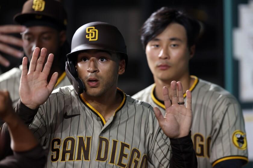 The Padres' Trent Grisham celebrates after scoring