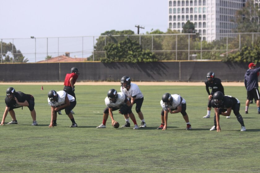 The Vikings run drills at practice, in preparation for the Sept. 2 blast-off game.