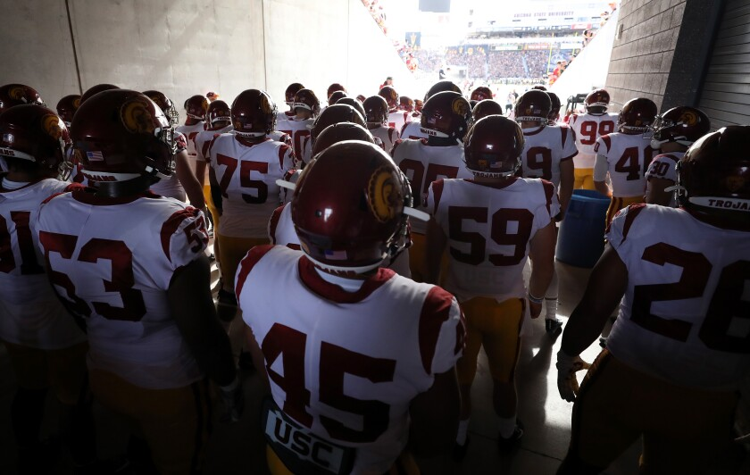 USC football players take the field before a game against Arizona State on Nov. 9.