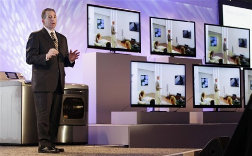 Tim Alessi, LG's Director of New Product Development for Home Electronics, talks about 3D HDTV technology during a press preview at the Consumer Electronics Show Wednesday, Jan. 5, 2011 in Las Vegas. (AP Photo/Julie Jacobson)