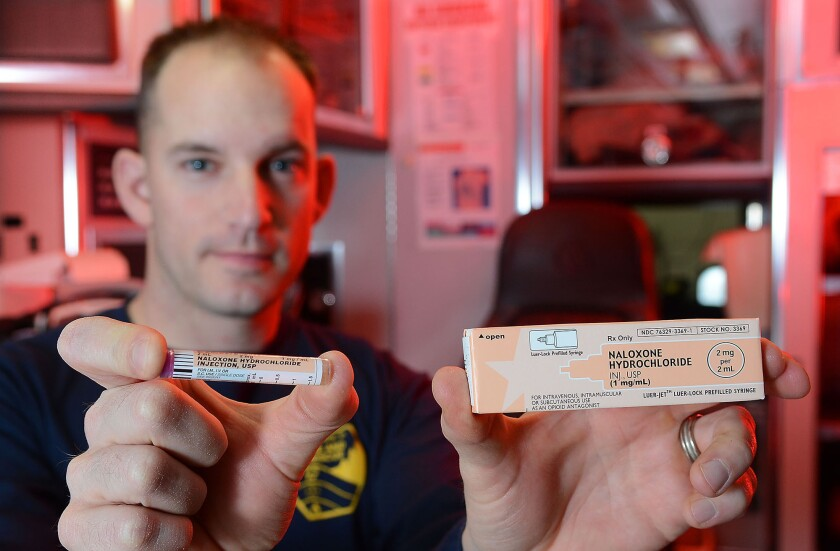 Eau Claire, Wis. Fire Department EMT and Paramedic Matt Gunderson holds a dose of naloxone.