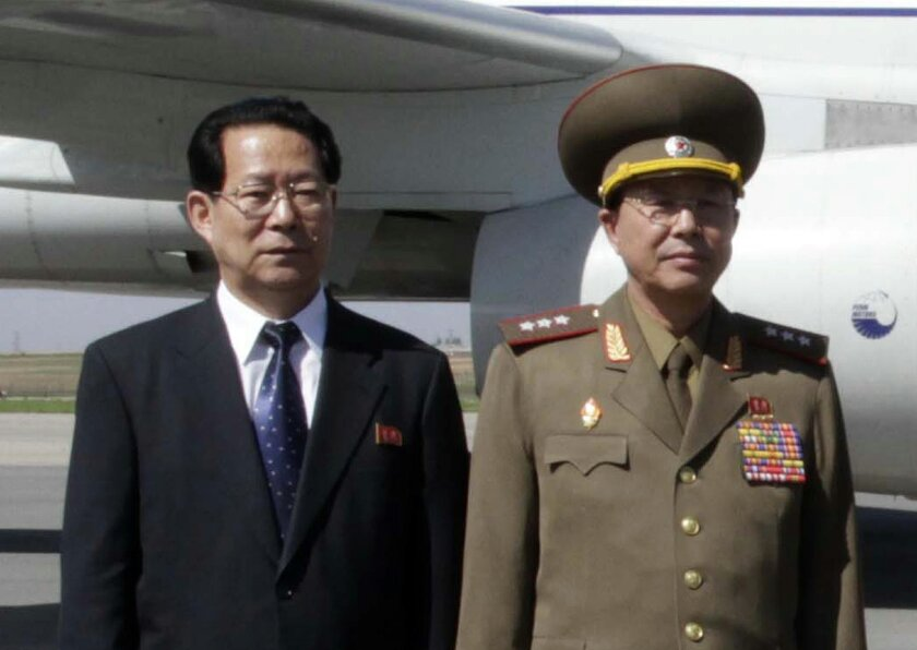 FILE - In this May 22, 2013 file photo, Kim Hyong Jun, left, deputy minister Foreign Affairs, and  Ri Yong Gil,  col. gen. of the Korean People's Army, pose before leaving Pyongyang Airport in North Korea for China.  South Korea says North Korean leader Kim Jong Un had his military chief executed f