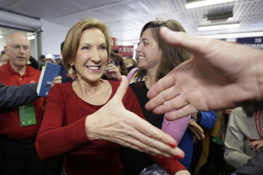GOP presidential candidate Carly Fiorina, seen here greeting supporters at a Republican event in Michigan on Saturday, got top marks in a new poll for her performance in Wednesday's debate.