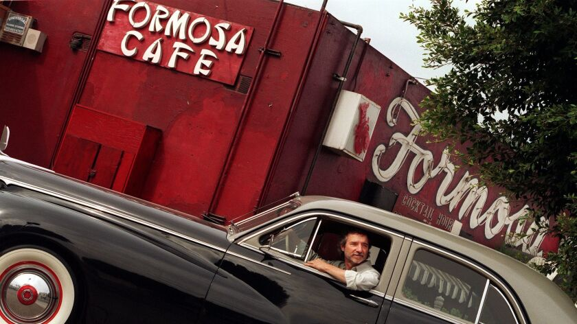 "Upcoming film ""L.A. Confidential"" with film's director Curtis Hanson, driving around to some of the"