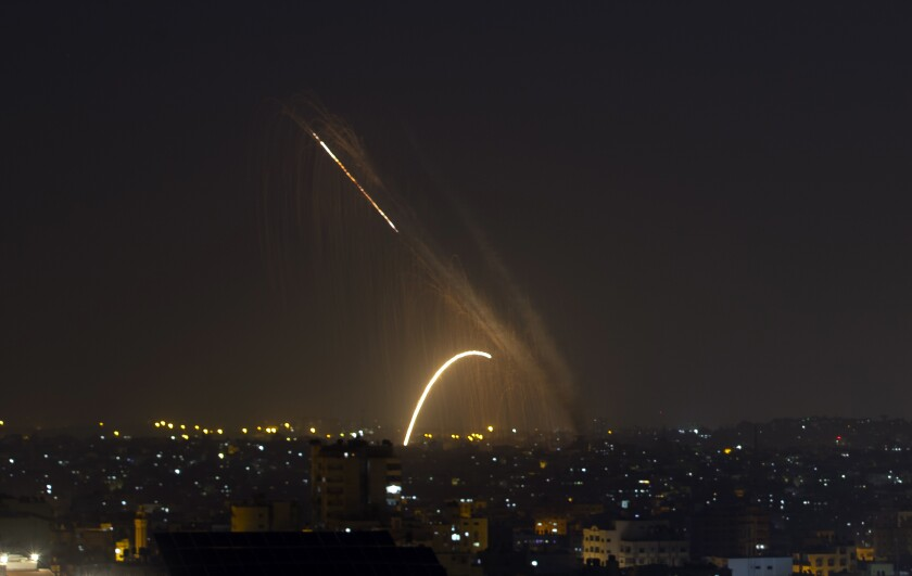 Rockets are launched from the Gaza Strip towards Israel, Wednesday, Nov. 13, 2019. Israeli aircraft have struck Islamic Jihad targets throughout the Gaza Strip while the militant group rained scores of rockets into Israel for a second straight day as the heaviest round of fighting in months showed no signs of ending. (AP Photo/Khalil Hamra)