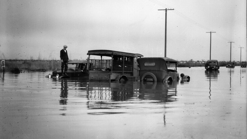 Feb. 4, 1927: Vehicles stalled at the intersection of West Vernon and Eleventh Avenue after rains le