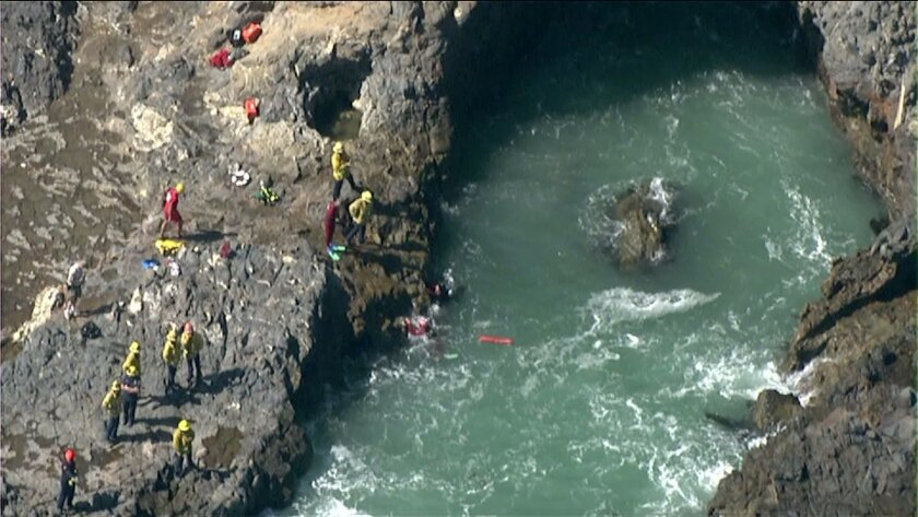 Rescuers search Wednesday for a swimmer reportedly submerged in the ocean near Rancho Palos Verdes.