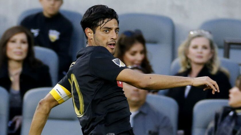 LAFC forward Carlos Vela controls the ball during a match against the Portland Timbers in March.