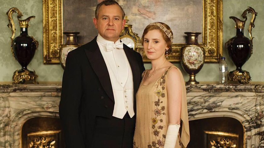 """Hugh Bonneville and Laura Carmichael star with an unfortunately placed water bottle in a photo promoting the new season of """"Downton Abbey."""""""