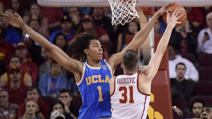 UCLA freshman center Moses Brown, defending USC's Nick Rakocevic, may be the only Bruin who could sneak into the first round of the draft.