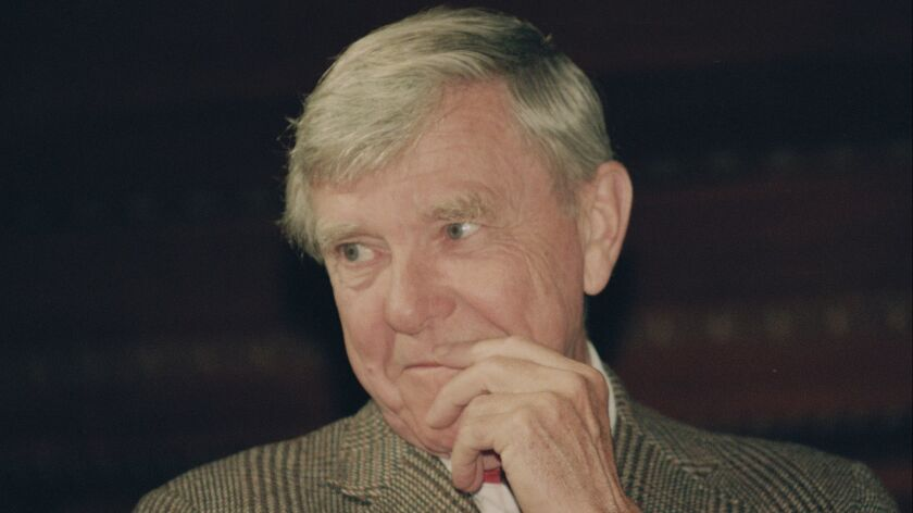 """Russell Baker ponders a reporter's question during a New York news conference where he was presented as the successor to host Alistair Cooke for the PBS series """"Masterpiece Theatre,"""" on Feb. 23, 1993."""
