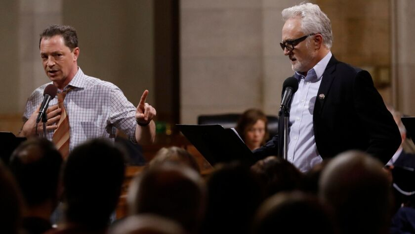 """Joshua Malina, left, as Carl Bernstein and Bradley Whitford as Bob Woodward read the screenplay to """"All the President's Men"""" on Saturday in a presentation organized by the Fountain Theatre in Los Angeles City Council chambers at City Hall."""