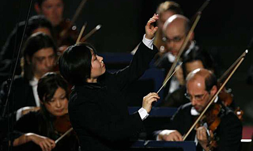 """TRAILBLAZER: """"I try not to be too sensitive to the fact that I'm a woman,"""" says Xian Zhang, leading Milan's Verdi Orchestra. The first female music director of an Italian orchestra, she is appearing with the L.A. Phil this weekend."""