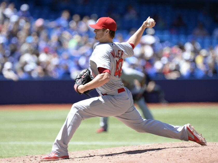 St. Louis Cardinals' pitcher Shelby Miller throws against the Toronto Blue Jays during the first inning of a baseball game in Toronto, Saturday, June 7, 2014. (AP Photo/The Canadian Press, Frank Gunn)