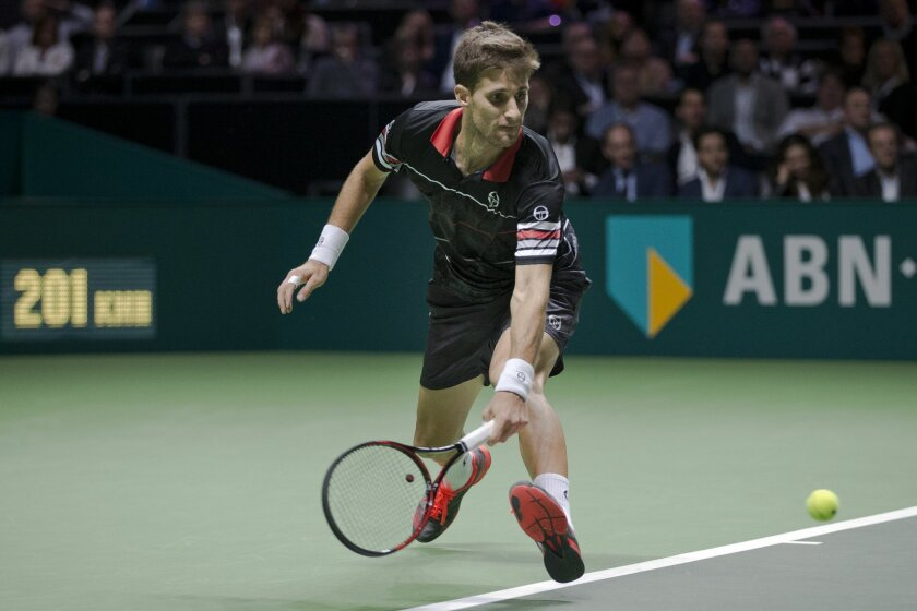Slovakia's Martin Klizan returns against France's Gael Monfils during the final of the ABN AMRO world tennis tournament at the Ahoy arena in Rotterdam, Netherlands, Sunday, Feb. 14, 2016. (AP Photo/Peter Dejong)