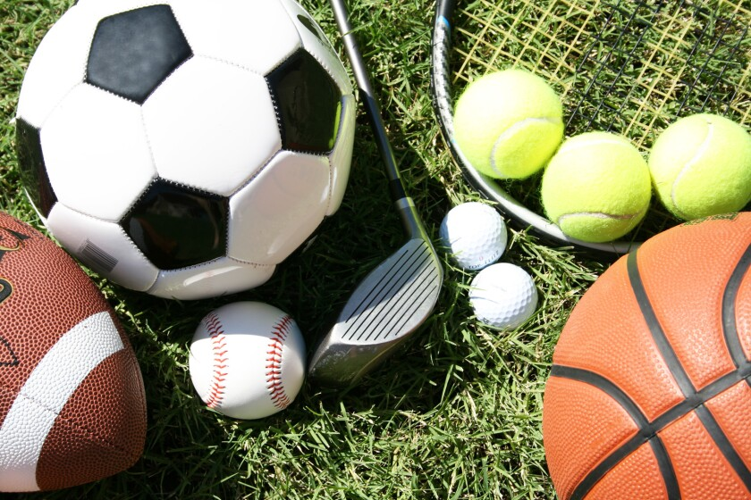 various sports items - football, basketball, golf club and balls, baseball, soccer ball, tennis racket and balls