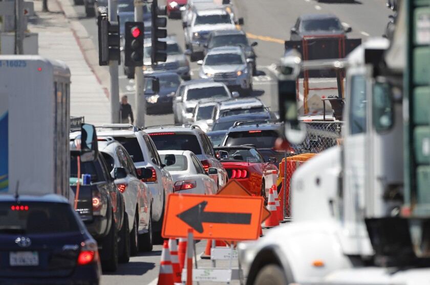 Traffic moves past the Laguna box culvert construction project in downtown Laguna Beach on April 29.