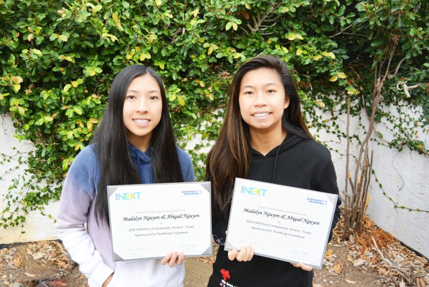 Abigail and Madalyn Nguyen with their awards.